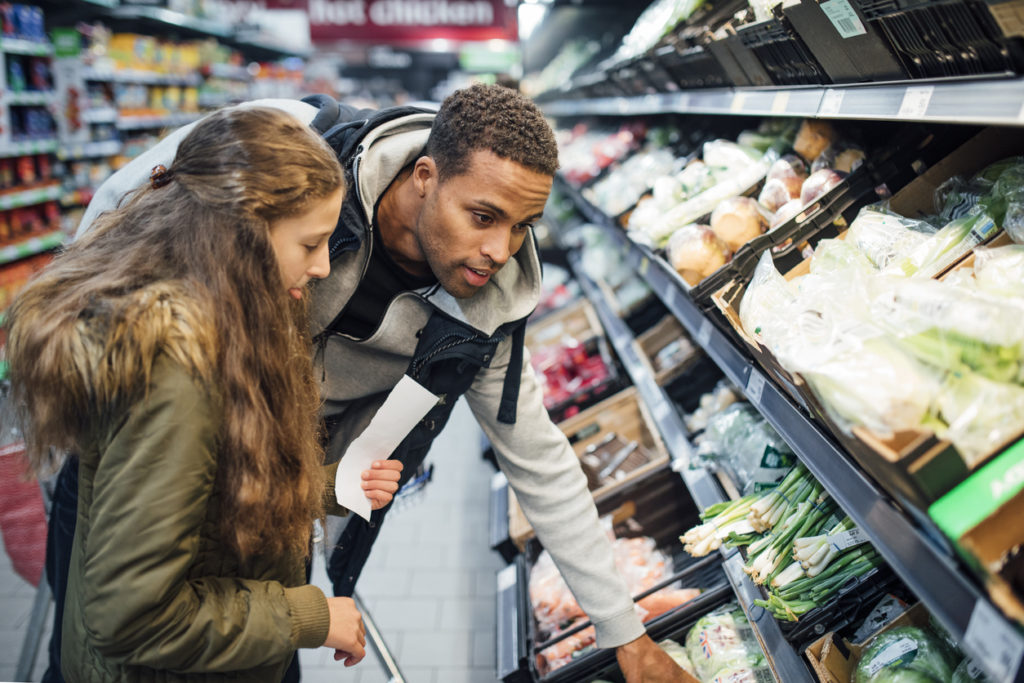 grocery shopping with foster daughter with a list to prevent overspending